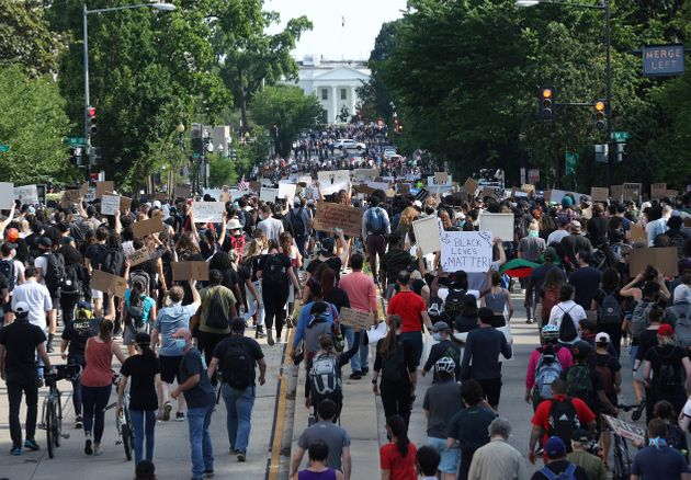 Hundreds of demonstrators march toward Lafayette Park and the White House to protest against police brutality...
