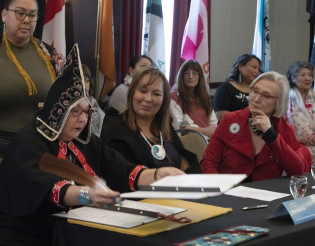 Carolyn Bennett (right), minister of Crown-Indigenous Relations and Francyne Joe (centre, former president...