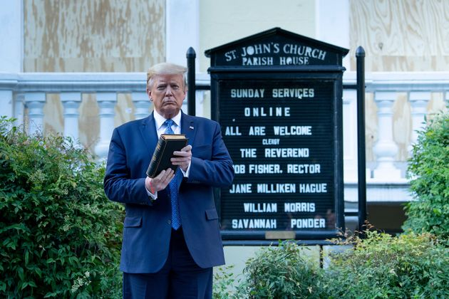 President Donald Trump holds a Bible while visiting St. John's Church on