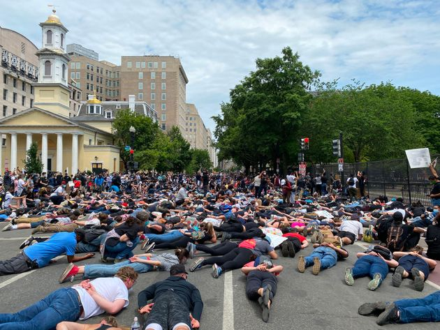 Protesters lie down in front of Lafayette Square and St. John's Episcopal Church on