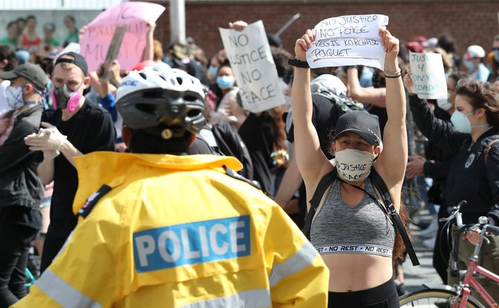 Protesters demonstrate against anti-black racism over allegations of police involvement in the death of 29-year-old Regis Korchinski-Paquet in Toronto on May 30, 2020.