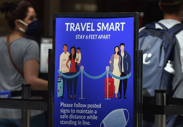 A sign reminding passengers to stay six feet apart is seen at a screening checkpoint at Orlando International