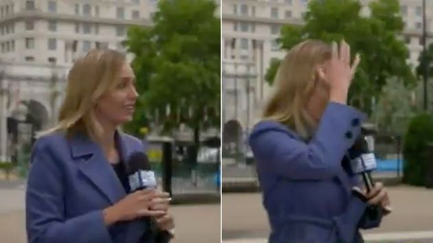 Channel Nine reporter Sophie Walsh was grabbed by a stranger during a live TV cross from London