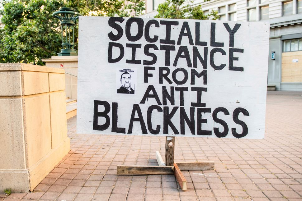 A sign at City Hall in Oakland, California, on June 2, 2020, after the police killing of George Floyd.
