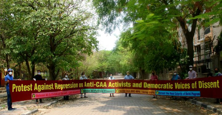 People protest against the arrest of anti-CAA activists in Delhi on Wednesday, June 3, 2020.