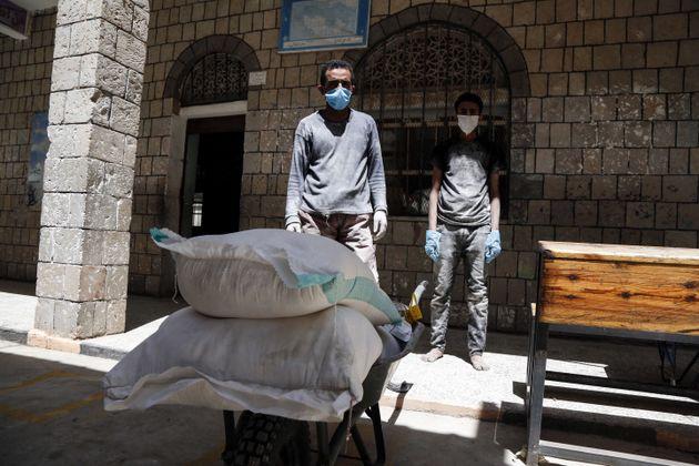 SANAA, YEMEN - JUNE 03: Food aid sent by World Food Program (WFP) is being distributed to needy people...