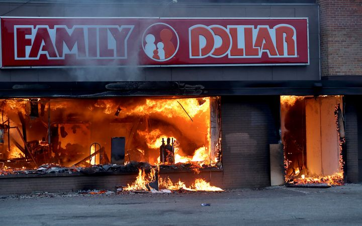Fire burns inside a Family Dollar Store, where many community members buy groceries, after a night of unrest in Minneapolis on Friday, May 29.