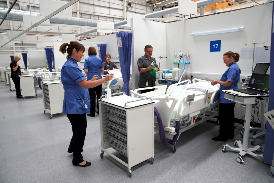 Staff prepare bays at the NHS Nightingale Hospital North East in