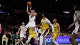 Brooklyn Nets' Spencer Dinwiddie (26) shoots over Los Angeles Lakers' Anthony Davis, center, during the second half of an NBA basketball game Tuesday, March 10, 2020, in Los Angeles. (AP Photo/Marcio Jose Sanchez)
