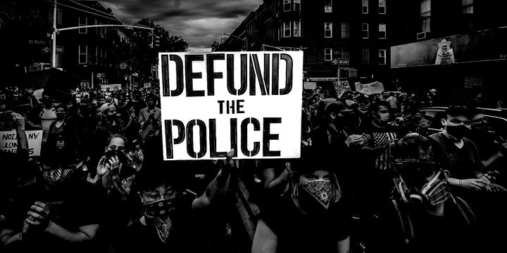 """As demonstrations spotlighting racial injustice and police brutality continue, the chorus is growing to """"defund"""" law enforcement agencies. This sign was held aloft in New York City."""