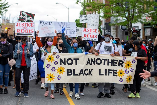 Friends and family of Regis Korchinski-Paquet lead protesters as they march on May 30, 2020 to protest...