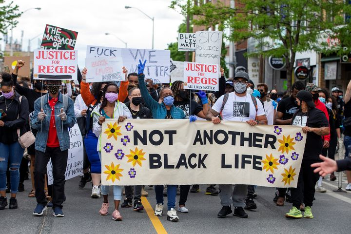 Friends and family of Regis Korchinski-Paquet lead protesters as they march on May 30, 2020 to protest the deaths in the U.S. of Ahmaud Arbery, Breonna Taylor and George Floyd, and of Toronto's Regis Korchinski-Paquet, who died after falling from an apartment building while police officers were present.