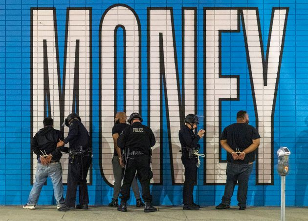 Fully equipped police in Los Angeles make arrests on Monday after a curfew went into effect during demonstrations...