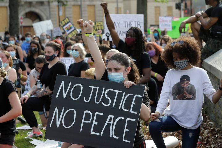 People attend a protest against police brutality on June 4, 2020, in Taunton, Mass.
