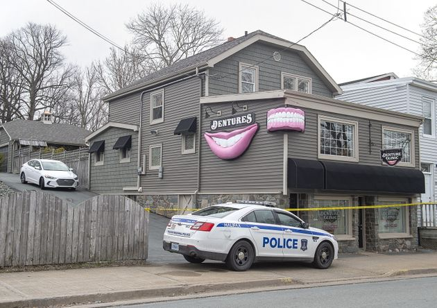 The Atlantic Denture Clinic is guarded by police in Dartmouth, N.S. on April 20,