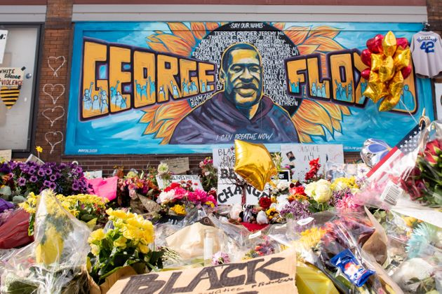 Community members gather in Minneapolis, where George Floyd was killed. The intersection served as a...