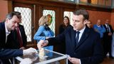 French President Emmanuel Macron casts his ballot during the first round of the mayoral elections in Le Touquet, western France, on March 15, 2020. - Officials have been told to disinfect voting booths and ballot boxes throughout the day, and sinks and hand gels will be made available. People will be urged to get in and out quickly to avoid lines, and floor markings will be laid out to ensure they stay one metre (3.3 feet) from one another. Authorities have already eased proxy voting rules for people at risk or infected with coronavirus and ordered to confine themselves to their homes, as well as for people in retirement homes. People can also come with their own pens for marking ballots. (Photo by PASCAL ROSSIGNOL / POOL / AFP) (Photo by PASCAL ROSSIGNOL/POOL/AFP via Getty Images)
