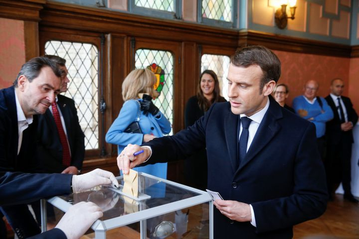 French President Emmanuel Macron casts his ballot during the first round of France's municipal elections on March 15, 2020.