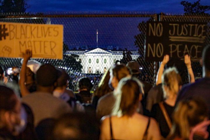 Thousands of peaceful demonstrators holding banners gather in front of the White House on June 2, 2020to protest the de