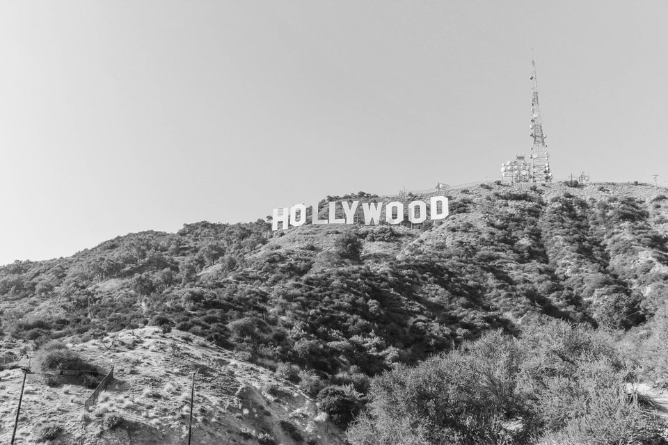 Hollywood's traditional film studio-cinema relationship is under strain due to the