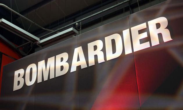 A Bombardier logo sits on a presentation platform at a railcar factory in Derby, U.K., on May 15, 2014.Bombardier...