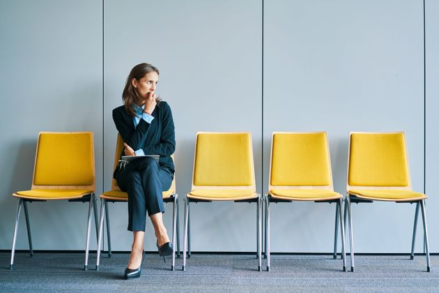 Stressful young woman waiting for job