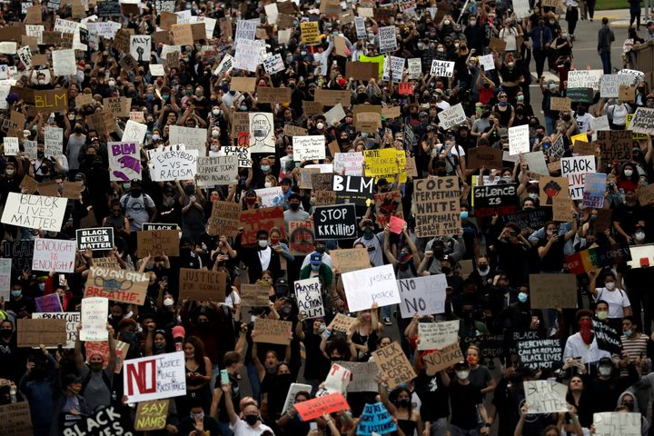 Protesting could get you fired depending on who you work for and where you live. Above, protesters march Thursday, June 4, 2020, in San Diego.