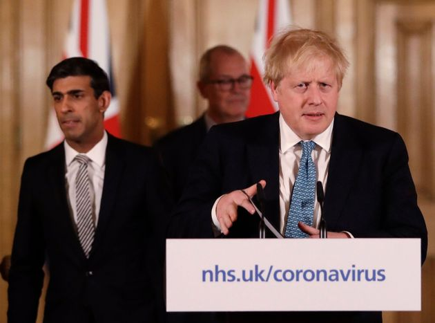 Chancellor Rishi Sunak, left, and Prime Minister Boris Johnson arrive for a press briefing at Downing