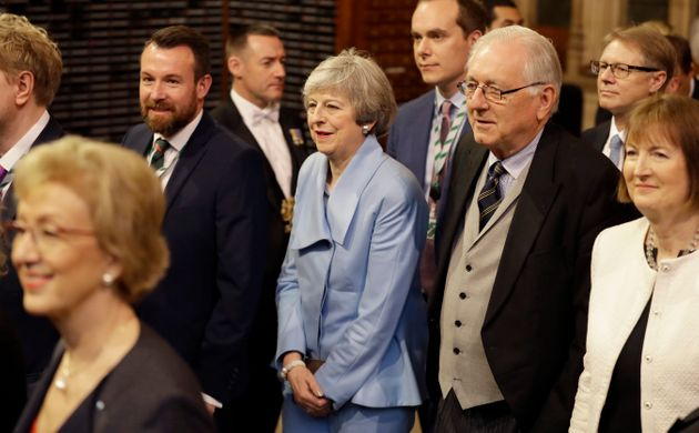 Theresa May walks with other Members of Parliament through the Commons Members Lobby to hear the Queens's...