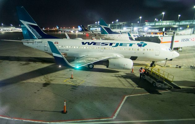 WestJet passenger planes at Lester B. Pearson International Airport in Toronto, March 24, 2020. WestJet...