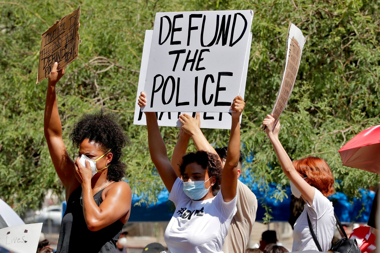 Protesters rally on June 3 in Phoenix demanding the city council defund the police department. The protest, like others nationwide, was sparked by the death of George Floyd, a Black man who was killed by Minneapolis police on May 25.