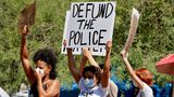 Protesters rally Wednesday, June 3, 2020, in Phoenix, demanding the Phoenix City Council defund the Phoenix Police Department. The protest is a result of the death of George Floyd, a black man who died after being restrained by Minneapolis police officers on May 25. (AP Photo/Matt York)