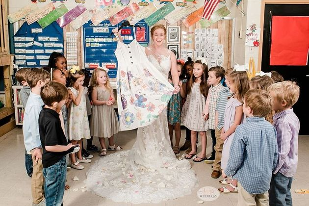 Smith shows off the dress her class made for her.