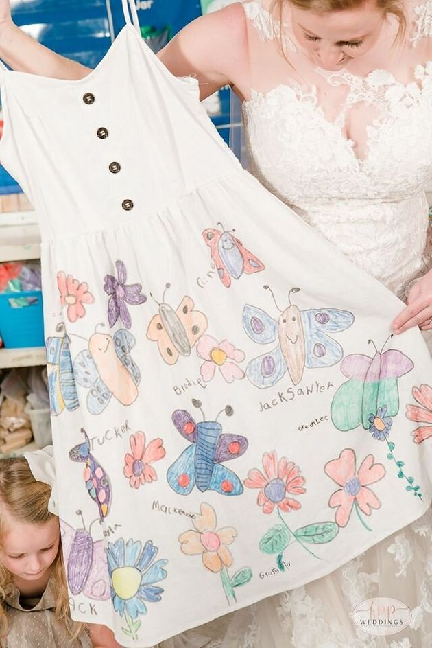 All of her students signed their names on the dress, making it the perfect keepsake.