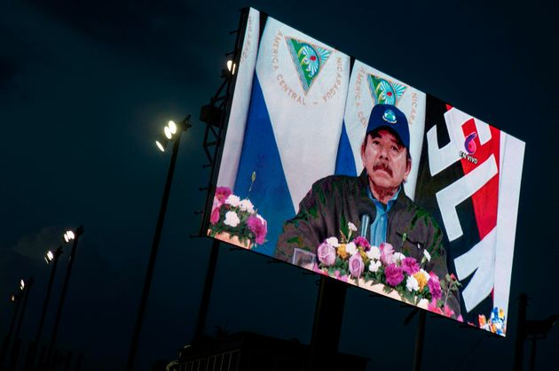 View of a screen broadcasting President Daniel Ortega during the 125th anniversary of the birth of General...