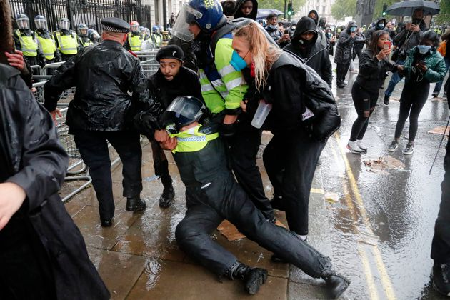 A police officer was injured when falling of a horse during scuffles with demonstrators at Downing