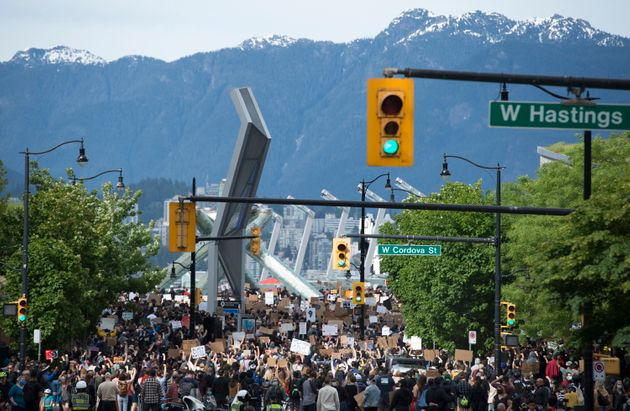 Thousands of people gather for a peaceful rally in Vancouver on