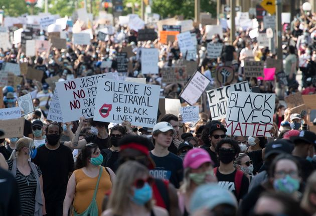 Thousands of protestors make their way through the downtown core during a Black Lives Matter protest...