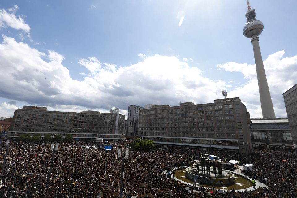 Alexanderplatz in Berlin, Germany, is seen fully crowded with people holding banners and placards as...
