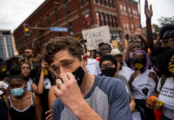 Minneapolis Mayor Jacob Frey leaves after declining to say he would fully defund the police at a protest on Saturday.
