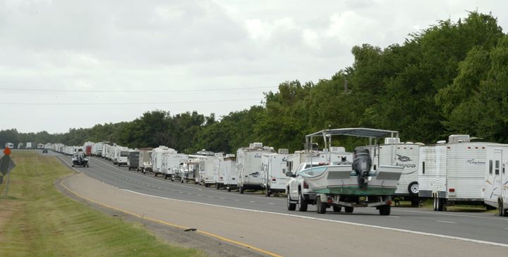 Recreational trailers and boats are parked along LA-46 inside the levee gates in anticipation of Tropical Storm Cristobal in