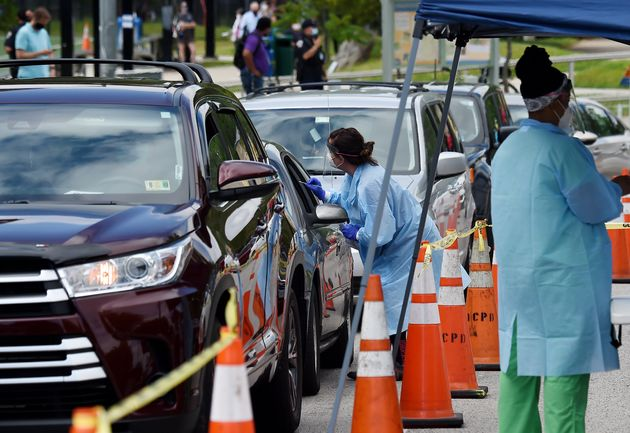 People get free COVID-19 tests at a drive-through and walk up Coronavirus testing centre located at Barcroft...