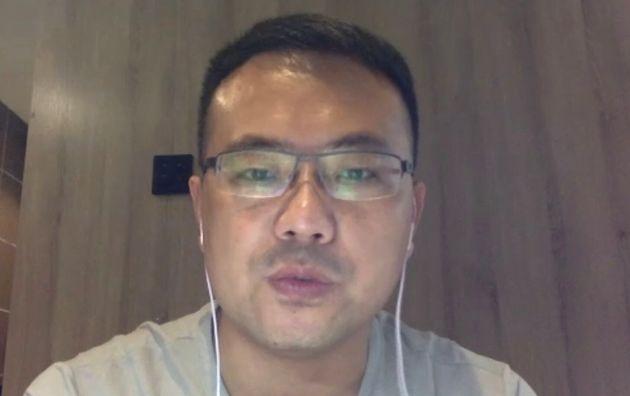 オンライン取材に応じる微医の張貴民・副総裁