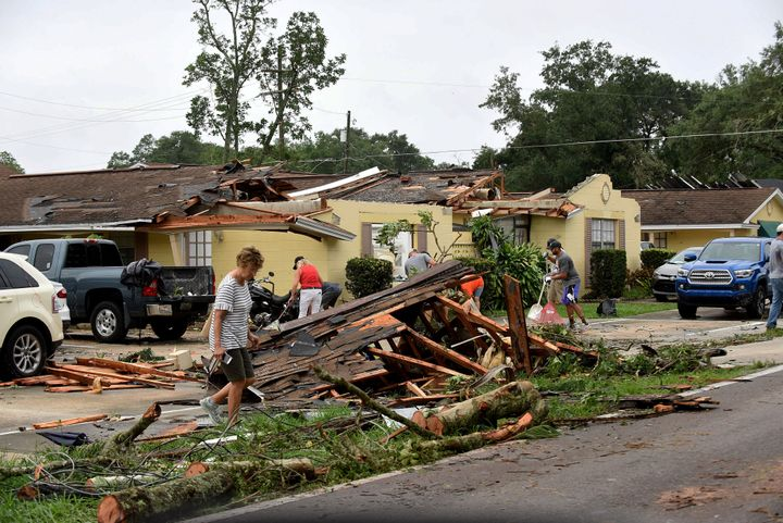 People clean up debris from their damaged apartments during the aftermath of Tropical Storm Cristobal.