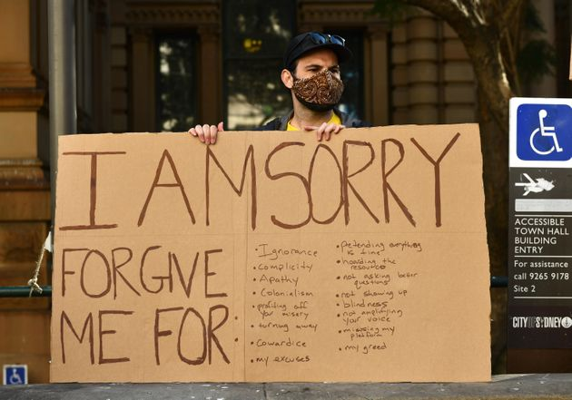 A protester at the Sydney rally, organised to protest Aboriginal deaths in custody in Australia as well...
