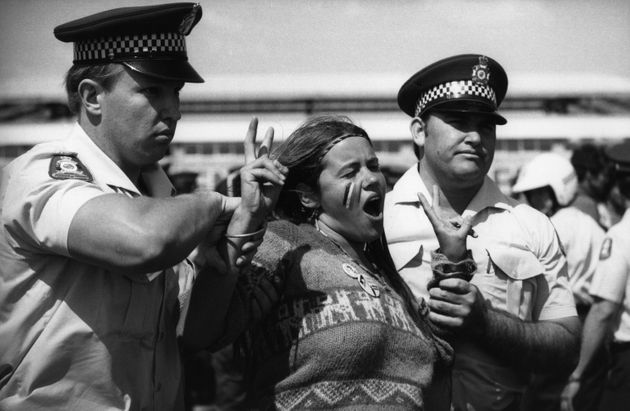 Police arrest a First Nations woman during a demonstration for Aboriginal land rights at the 1982 Commonwealth...