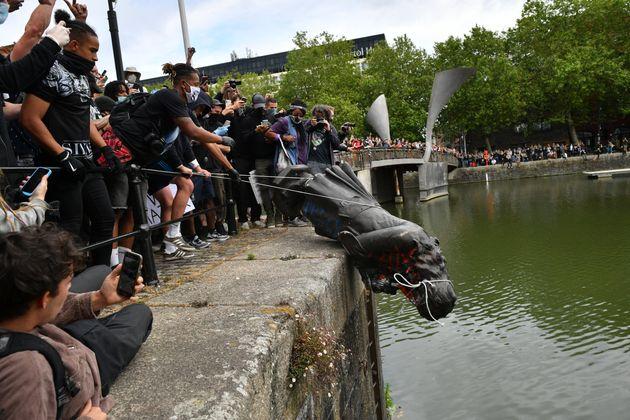 Protesters throw statue of Edward Colston into Bristol