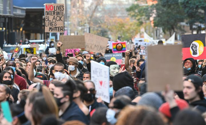 """Tens of thousands of protestors marched in solidarity with """"Black Lives Matter"""" in most major cities across Australia at the weekend. (Photo by James D. Morgan/Getty Images)"""