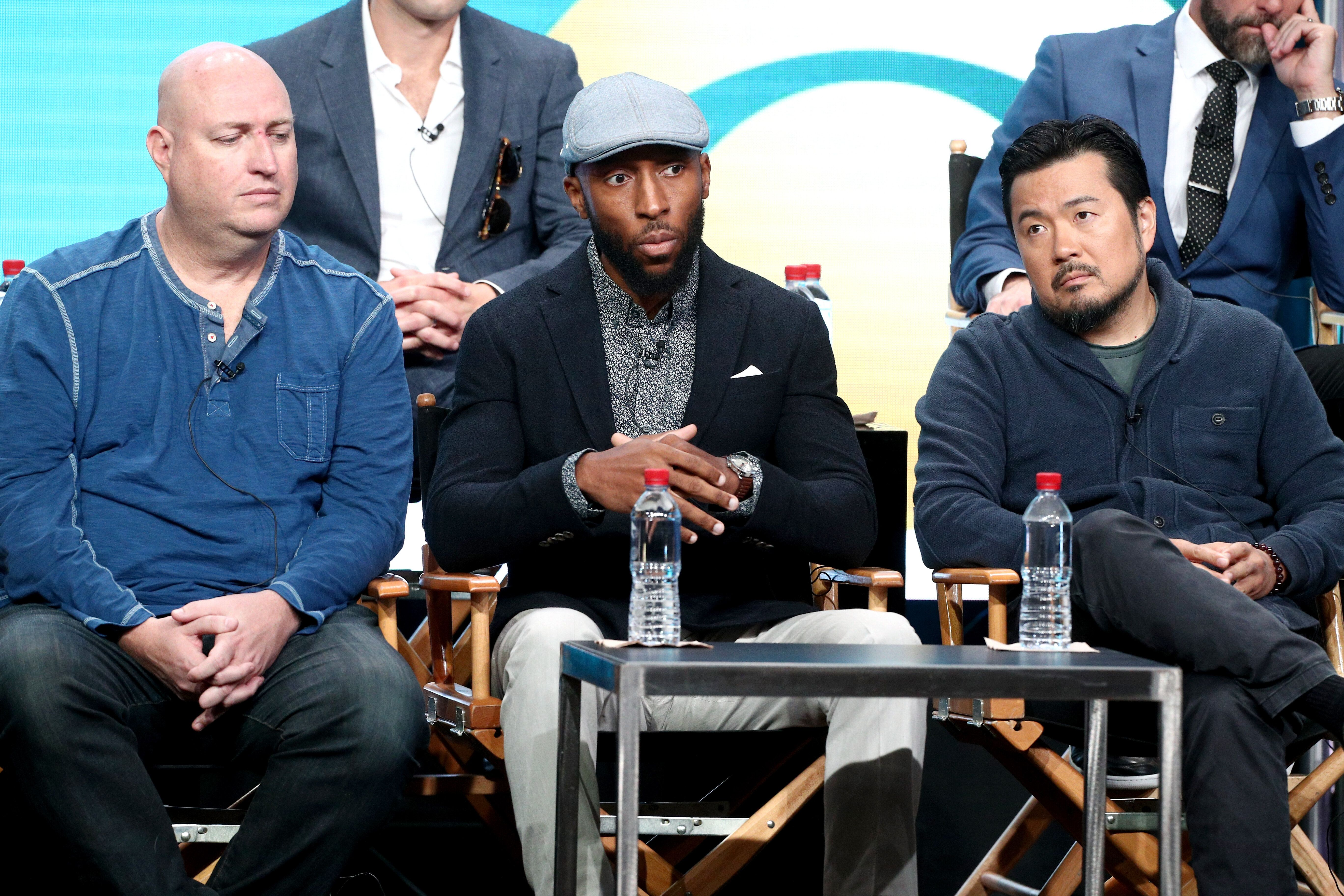 Executive producers Shawn Ryan (left), Aaron Rahsaan Thomas (middle) and Justin Lin (right) of 'S.W.A.T.' speak onstage during the CBS portion of the 2017 Summer Television Critics Association Press Tour at The Beverly Hilton Hotel on August 1, 2017 in Los Angeles.