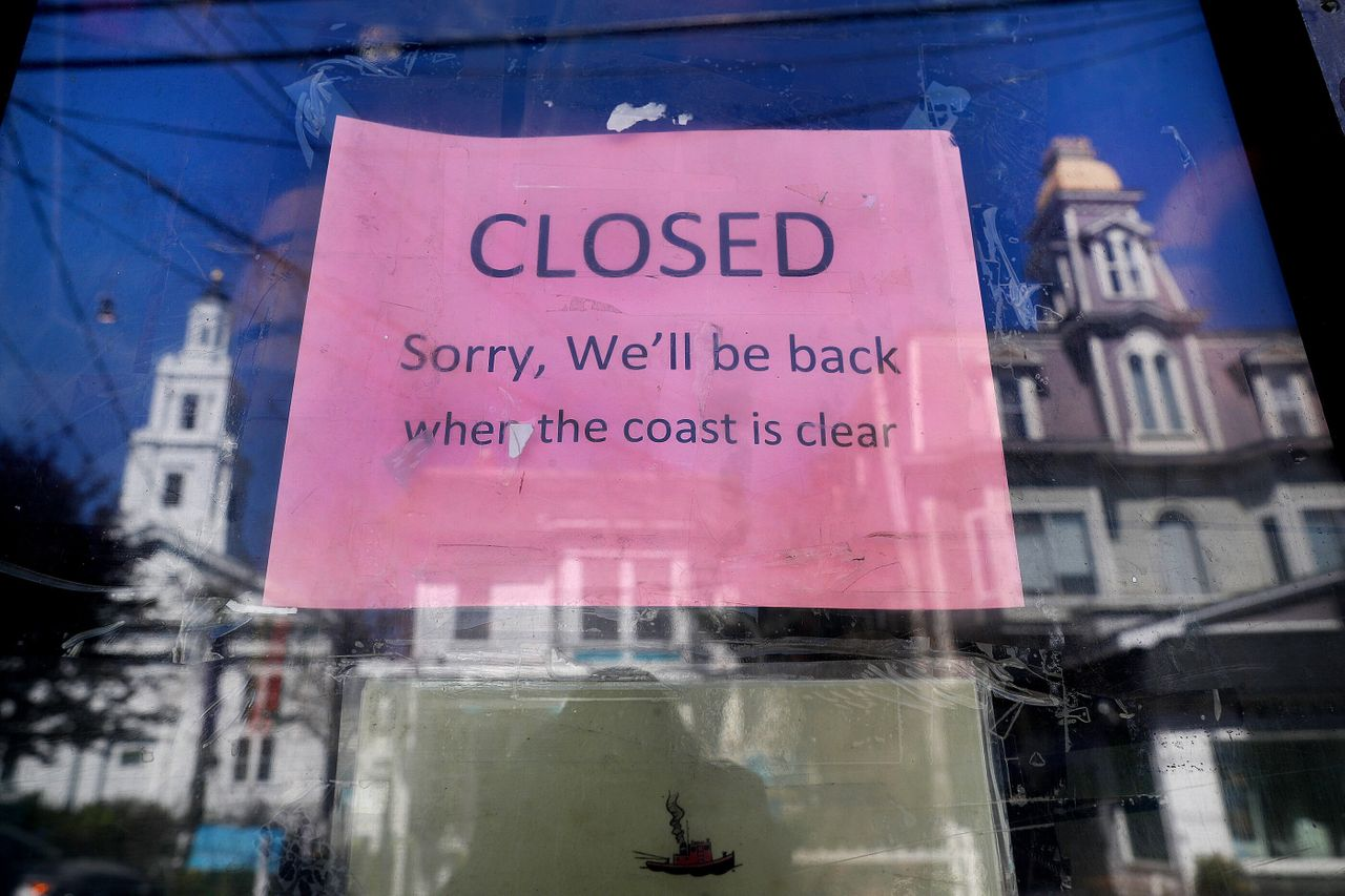 A sign on the Marine Specialties store on Commercial Street in Provincetown tells customers that the store is closed on May 13.